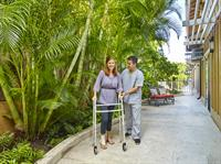 Wilson Care Professional walking with a client.