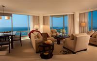 Gallery Image Living_Room_and_Dining_Area_of_Premium_3_Bedroom_Ocean_Front_Suite_Trump_Waikiki.jpg