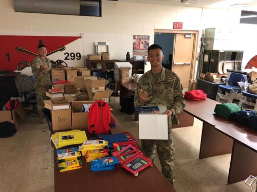 Operation Homefront provided school supplies for military children on Oahu. Here are volunteers from 1.299 CAV packing up supplies for military children on both Oahu and Kauai.