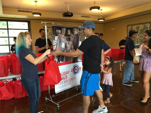 Holiday Meals for Military 2017 on Hickam AFB - Operation Homefront was able to serve 200 military families at the annual HMFM, providing them with a $25 grocery gift card, a bag of non-perishable food items and toys provided by both Operation Homefront and the Red Cross.