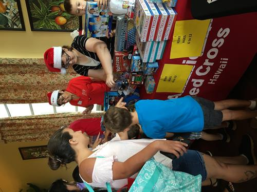 Holiday Meals for Military 2017 on Hickam AFB - Operation Homefront was able to serve 200 military families at the annual HMFM, providing them with a $25 grocery gift card, a bag of non-perishable food items and toys provided by both Operation Homefront and the Red Cross