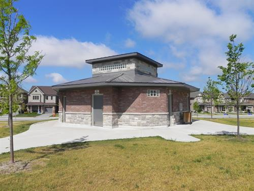 Park Block Washroom at the Treetops Subdivision in Alliston, ON. The building contains separate washroom facilities for men, women, and families along with the splash pad equipment.