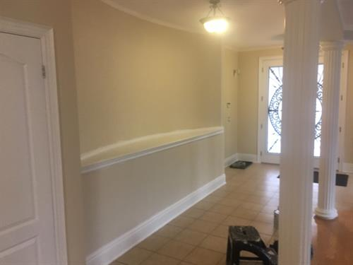 Our client wanted to freshen up their entrance.White trim certainly adds to a clean look!