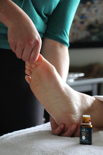 Vita Flex Technique - Aromatic Bodywork, applying essential oils to the feet