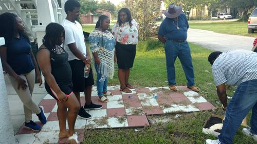 Youth Forensic Class conducts mock crime scene processing evidence