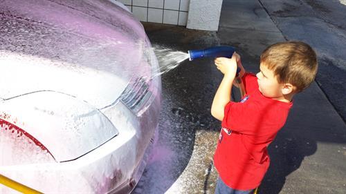 Gallery Image kids--boy-sprays-tri-foam.jpg