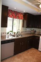 Kitchen re-design- New granite counter tops, back splash, new paint, tile floors- after