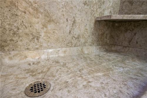 We angle our shower pans however needed for your drain