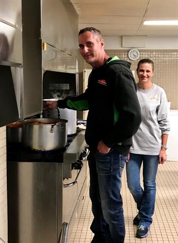 Jon, Owner, and Shannon, Office Manager, serving it up at the Soup Kitchen! (Supporting The Arnold House)