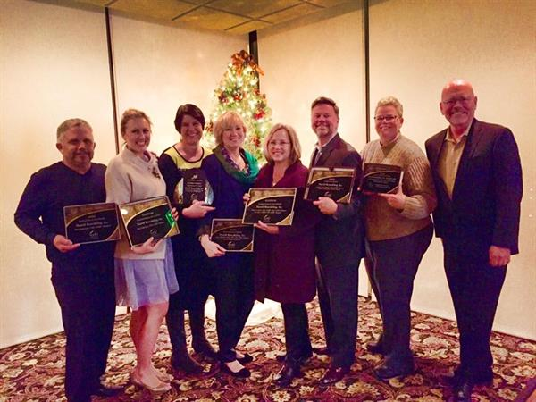 Employee-owners, Kai Jensen, Sara Jorgensen, Gloria Carlson, Genie Nowicki, Lisa Sten, Jamieson Simpson, Kristen Kleibor and Ciro Giammona accepting multiple design awards!
