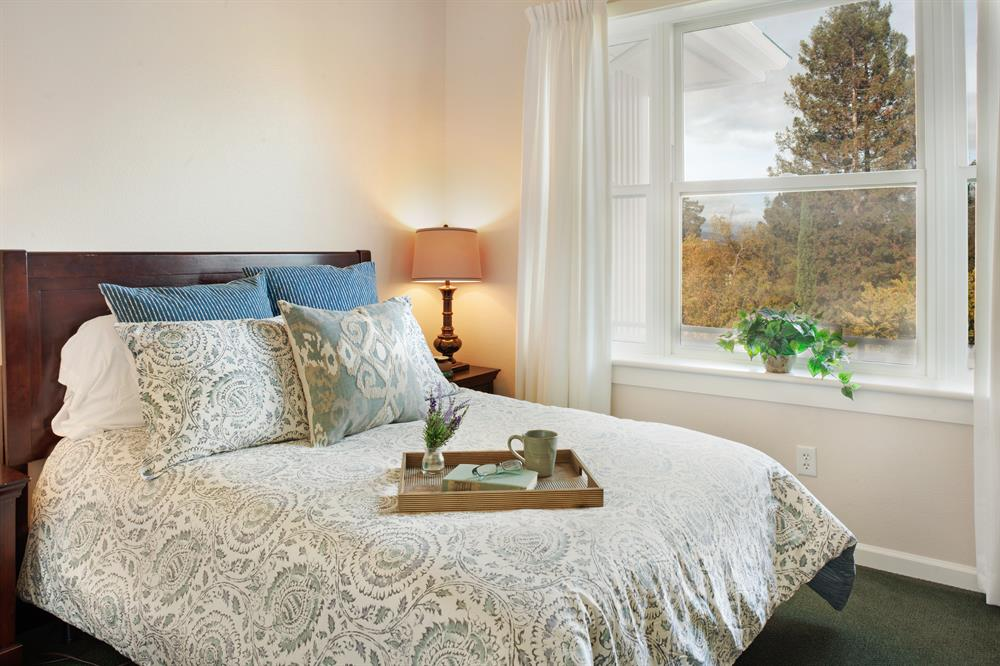 Sunrise of Palo Alto bedroom in a one-bedroom suite.  We also offer studio and companion suites.