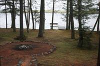 View From Inside Home to Fire Pit & Lake