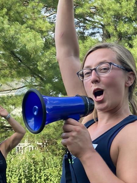 She does NOT need the megaphone! (LOL)