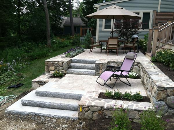 Stratham; Unlock paver two level patio, stone walls