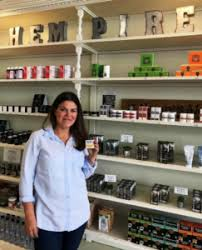 Owner Kirby showcasing health & wellness products