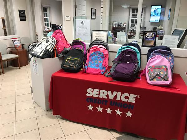 Here's an image from our Pack-A-Pack Drive in 2018! The Exeter Branch of Service Credit Union collected 115 backpacks and company wide we collected over 3,000 backpacks!