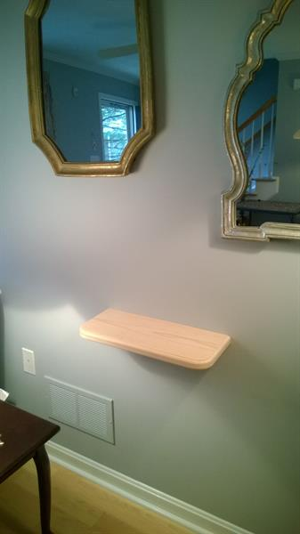 A recent client was thrilled with this shelf that we fabricated and installed for her. A little something that was done to spruce up a wall with no unsightly brackets and she still has space underneath.