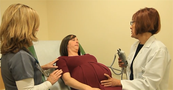 Dr. Pruna and Mary Brewer, RN with prenatal patient.