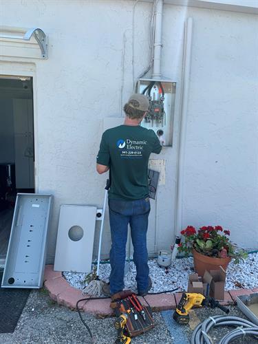 Quinn servicing an electrical panel.
