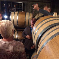 Barrel tasting with a wine thief