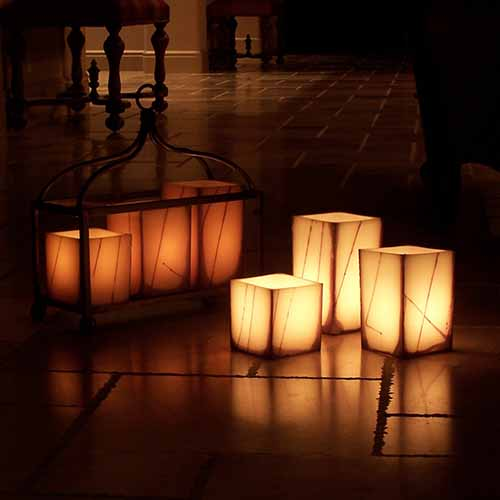 Oriental line wax luminaries and flameless candles by by Q Candles inc