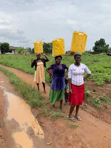 Moms of the students accessing clean water from school to bring home