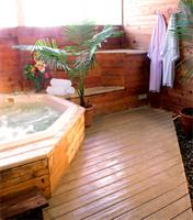 Our indoor tub rooms are open-air rooms with a locking door for privacy.