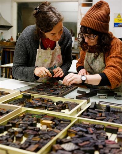 Artist Fiona Kelly delivering a relief print workshop