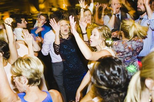 Gallery Image BARTLETT_weddings_Balue_reception_196_(Hands_Up).jpg