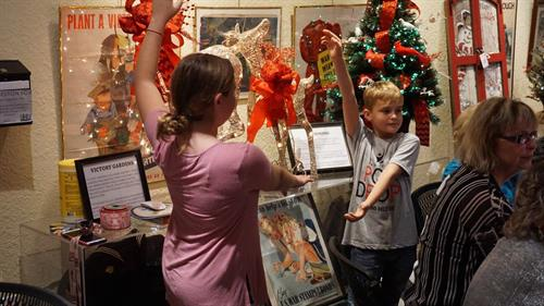 Auctioning off Christmas decor at our annual Wreaths, Toys, and Joys fundraiser