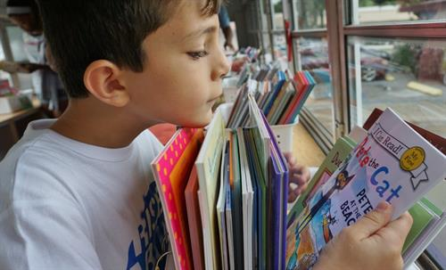 Our youth get free books from the Juvenile Welfare Board's Book Bus