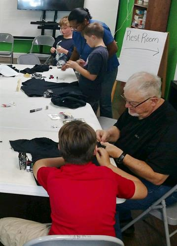 Rotary of Safety Harbor leads a Boys Mentoring Group at the Center, teaching the boys everything from sewing to how to change a tire.