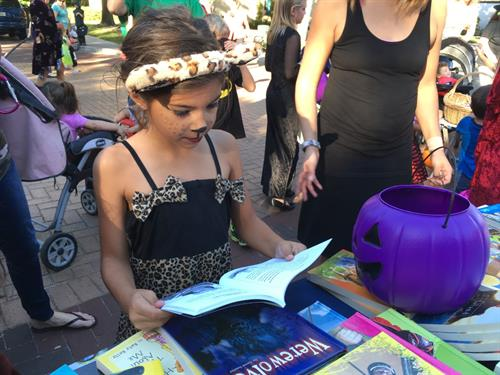 We gave away more than 900 free books on Halloween at Safety Harbor Main Street Trick or Treat