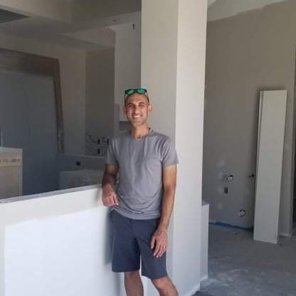 This is me, standing at the front desk in the middle of construction. We open on October 18th!