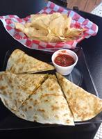 Friday Special - Chicken quesadilla with home made chips, queso & salsa!