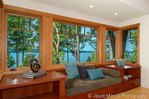Home staging with cozy window seat and spectacular view helped sell this Vashon home!