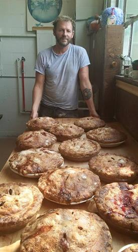 Adam making tons of pies.