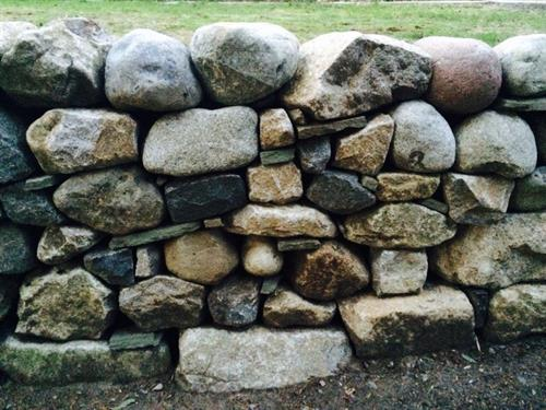 Local Vashon fieldstone mixed with blue and grey Washington granite, 4-foot retainer wall on Burma Road