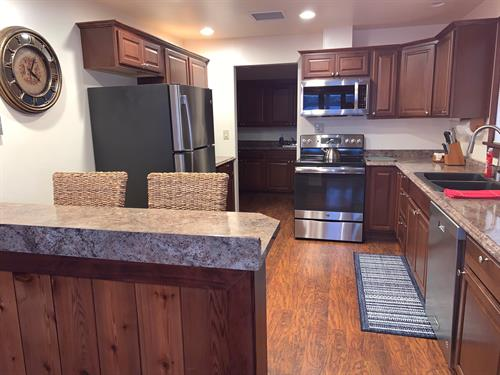 Full Kitchen, new appliances, open to dining area