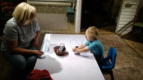 O and Grandma enjoying the dry erase table at Museum of the Grand Prairie.