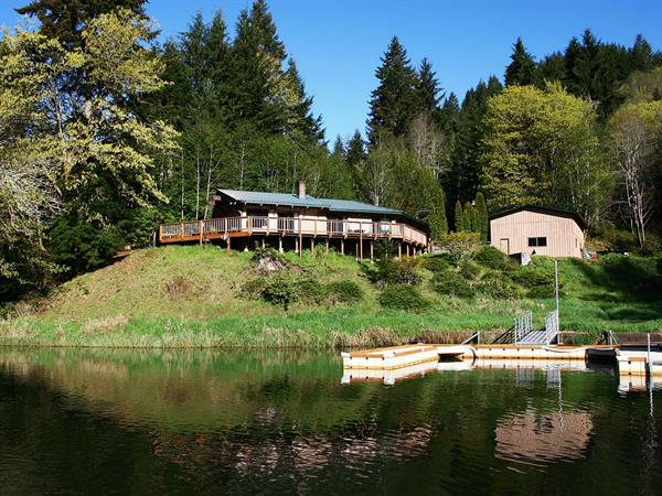 The Waterfront Vacation Home has a wraparound deck with view of the lake.
