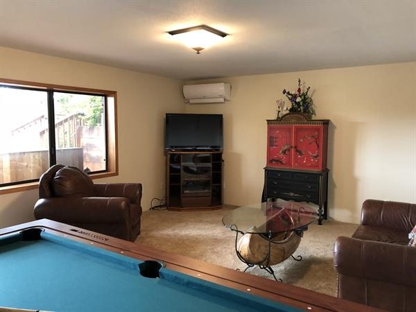 Family room with full sized pool/air hockey table