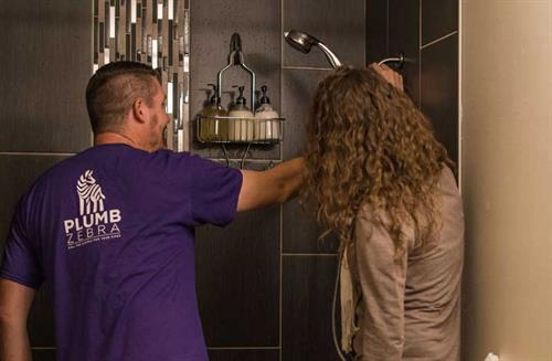 Gallery Image plumber-examining-shower-with-customer.jpg