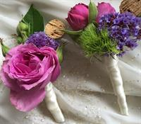 Custom boutonnieres with wine cork