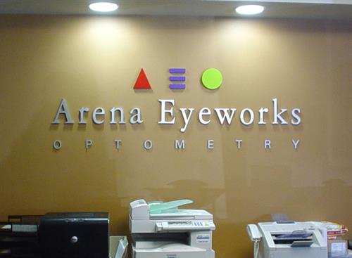 Arena Eyeworks cut out letters