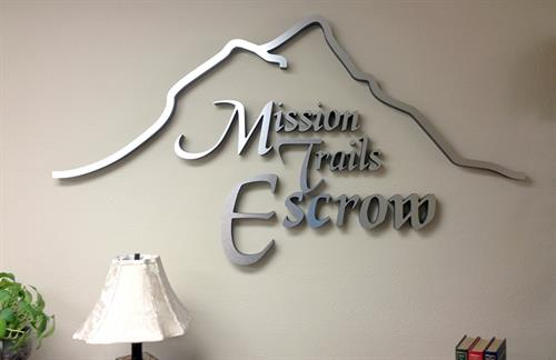 Office sign for Mission Trails Escrow