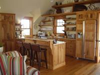 A country kitchen made of butternut wood.