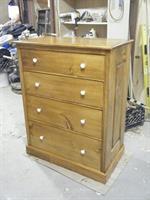 A dresser made of pine.