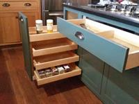 Kitchen pullouts, including a custom spice drawer.