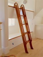 Bunk beds and a custom ladder in a new home.